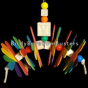 "Wooden blocks and colored craft spoons strung on paper rope with plastic beads. Hangs from nickel plated chain. Designed for birds who are light chewers.  Measures approx 8"" by 7"" including link."