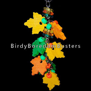 "Hardwood leaves, beads & rings on nickel plated chain. Designed for small birds who like hard wood or bigger birds who like small toys.  Hangs approx 8"" including link."