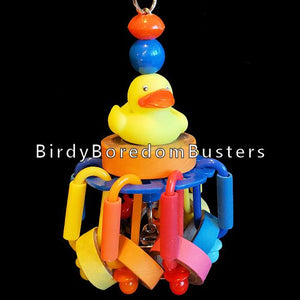 "Perched atop a chubby bagel is a little rubber duck with bitty bagels & mini pacifiers dangling on plastic links. Hidden inside is a nickel plated bell. Once the bagels are gone, simply refill with more!  Hangs approx 7"" including link."