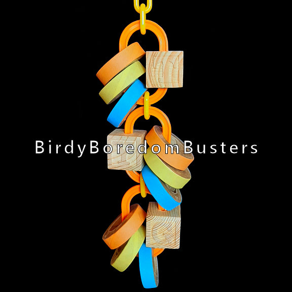 A refillable toy made with giant chain links, chubby birdie bagels and unpainted ABC blocks. Once the bagels are gone, simply refill with more!  Hangs approx 11