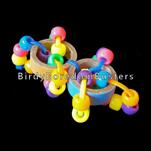 Two bitty bagels & pony beads joined together for a light weight foot toy for small to intermediate birds.  Measures approx 3