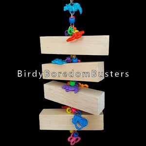 "Four 1"" x 1"" balsa wood blocks on nickel plated chain with pony beads and critter charms to rattle. Note: Balsa is an extremely soft wood and makes an excellent choice for birds who do not like to chew wood.   Hangs approx 4"" by 10-1/2"" including link."