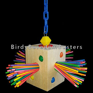 "A 3"" x 3"" x 4"" balsa block with colored paper sticks on all sides and beads inserted into the wood to entice your bird to chew. Hangs from plastic chain with a stainless steel wire running through the block to make this toy last till the end.  Measures approx 8"" by 10"" including link."