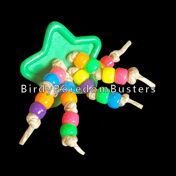 A giant plastic button with pony beads knotted on hemp cord. Designed for all medium to large sized birds. A top selling foot toy!!!