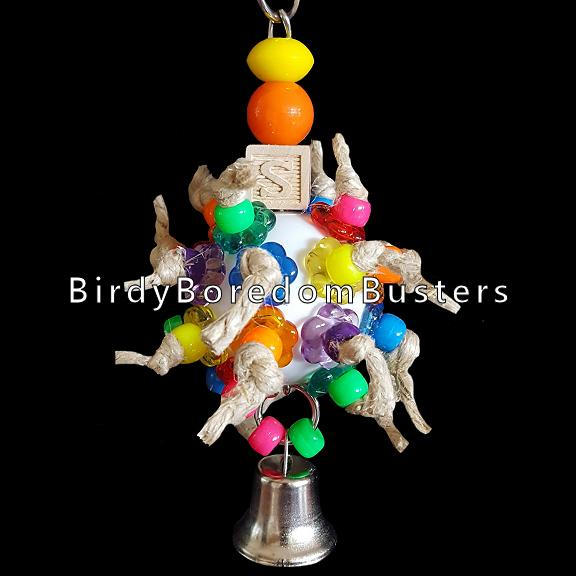 A perforated golf ball filled with pony beads & stringing rings on hemp cord. Finished off with a bell, mini ABC block and acrylic beads.  Hangs approx 6-1/2