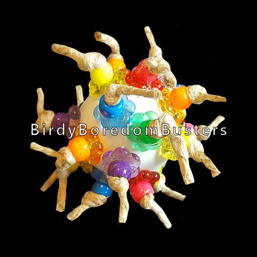 Lots of brightly colored pony beads & stringing rings knotted onto a plastic golf ball with hemp cord.  Designed for medium to large birds.