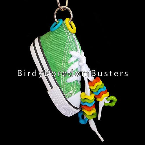 A miniature canvas tennis shoe decorated with wiggle rings. Makes a great foraging toy - simply hide a treat or two inside for foraging fun!  Note: Sneaker does not have metal grommets like some do!  Hangs approx 6