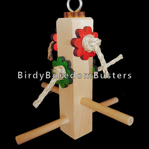 "A swing for multiple small birds to hang out and party on! 3/8"" diameter birch dowels on all sides of a 6"" block with colorful pine daisies to nibble and sisal rope to preen. Designed for extra small birds such as canaries and finches up to budgies, lovebirds and small conures.  Measures approx 7"" wide by 8"" including link."