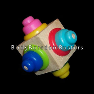 "An uncolored pine block with an array of bright, chewy plastic beads and washers on all sides (shape of beads will vary). Designed for medium and large birds.  Measures approx 3"" by 3""."