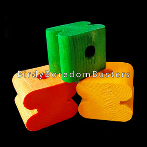 "Brightly colored notched pine blocks measuring approx 1-1/4"" by 1-1/2"" by 1-1/8"" tall with a 3/8"" center hole. Recommended for medium and large birds.  Package contains 30 blocks in assorted colors."