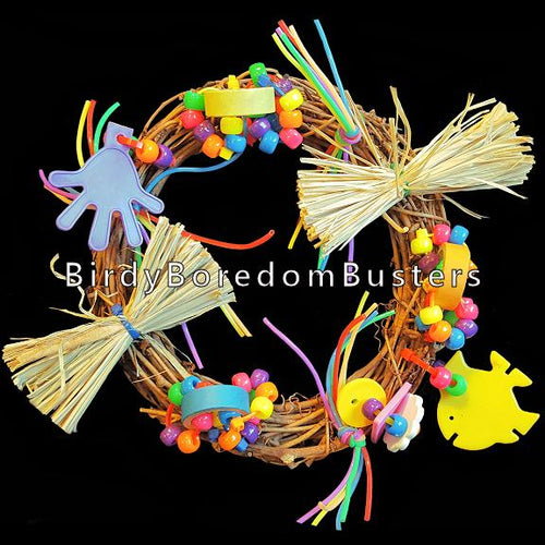 A grapevine wreath loaded with bitty bagels, buttons, beads, raffia & assorted doodads. Attach to cage with the included zip ties. Contains no metal parts.  Measures approx 7