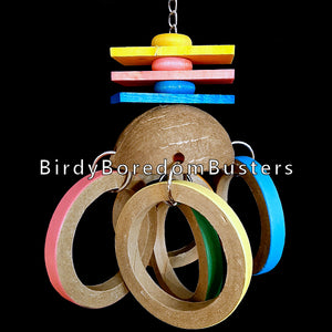 "Five large birdie bagels dangling from a coconut shell half with brightly colored softwood slats, wood disk rings and wood balls (inside the coconut) on nickel plated chain.  Measures approx 5"" wide by 11"" including link."