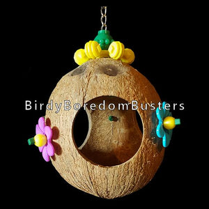 "A hideout swing for small birds made with a hairy coconut shell decorated with a spinning snowflake & daisy beads. Hangs on nickel plated chain. The coconut measures approx 4-1/2"" and has three 2"" holes with mini pacifiers dangling inside."