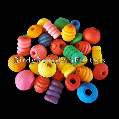 An assortment of brightly colored wood beads in different shapes. Sizes depend on the shape, but average approx 3/4