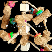 "Load image into Gallery viewer, Designed for cork lovers! Over a dozen 2"" corks with small wood blocks and bright daisy rings all tied onto paper twist rope. Great for birds who aren't big chewers and like chipping away at softer materials.  Hangs approx 14"" including link."