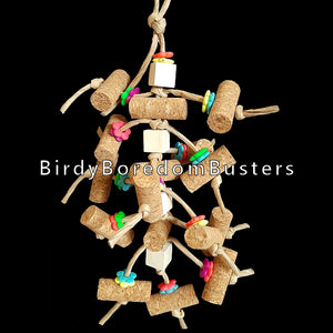 "Designed for cork lovers! Over a dozen 2"" corks with small wood blocks and bright daisy rings all tied onto paper twist rope. Great for birds who aren't big chewers and like chipping away at softer materials.  Hangs approx 14"" including link."