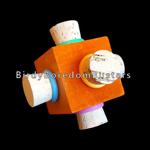 Corks with rubber rings stuffed into each side of a brightly colored pine cube. Designed for medium and large birds.  Measures approx 2-1/2