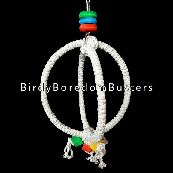 Sturdy steel rings wrapped with unbleached 100% cotton rope with brightly colored wood blocks & rings. A fun swing that provides a soft footing and promotes exercise and coordination. Designed for intermediate sized birds such as caiques, senegals, mini macaws and ringnecks.  Measures approx 7