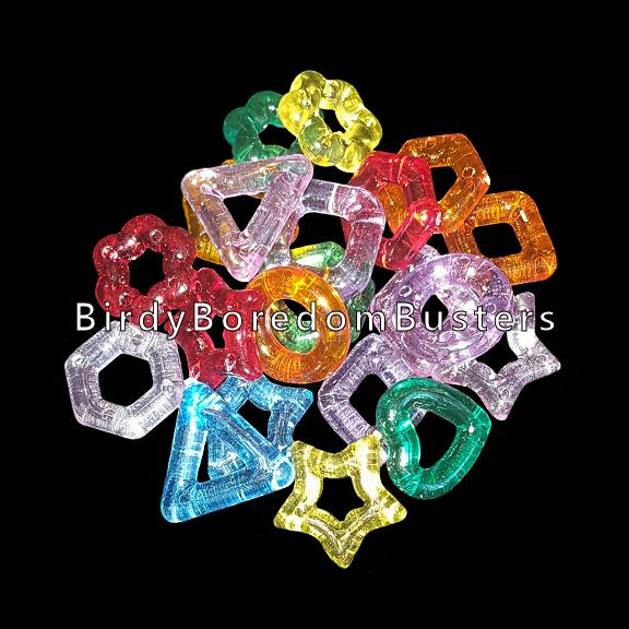 Little crystal colored rings in assorted shapes (heart, star, flower, triangle, square & more) measuring approx 5/8