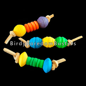 "An assortment of small foot toys made with colored wood beads strung on veggie tanned leather lace. Designed for small to intermediate birds. Approx 3-1/2"" long.  Package contains 5 toys in assorted styles & colors."