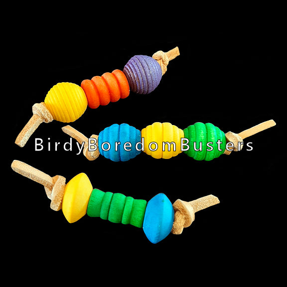 An assortment of small foot toys made with colored wood beads strung on veggie tanned leather lace. Designed for small to intermediate birds. Approx 3-1/2