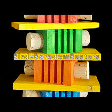 "Load image into Gallery viewer, Four brightly colored notched pine blocks with cork stoppers inserted into the sides with four softwood slats and wood beads all strung on paper rope. Contains no metal parts.  Measures approx 3-1/2"" by 11"" including link."
