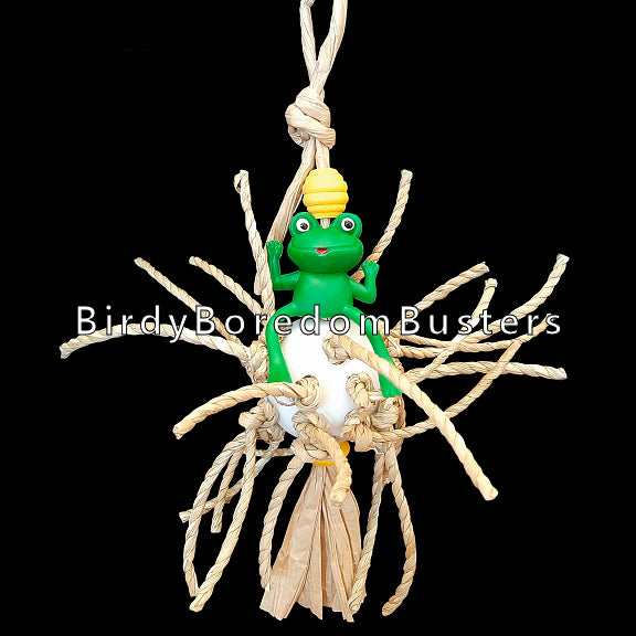 Twisted seagrass cord knotted on a perforated golf ball with a rubber frog and small wood beads. Toy hangs on paper twist rope. Birds love chewing on the crunchy seagrass!  Measures approx 5