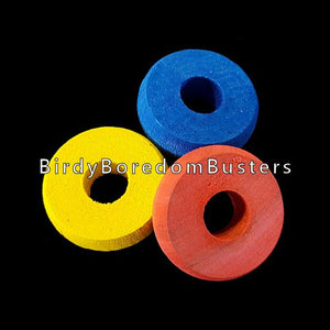 "Brightly colored wood rings measuring approx 1-1/4"" by 3/8"" thick with a 7/16"" hole.  Package contains 10 rings."