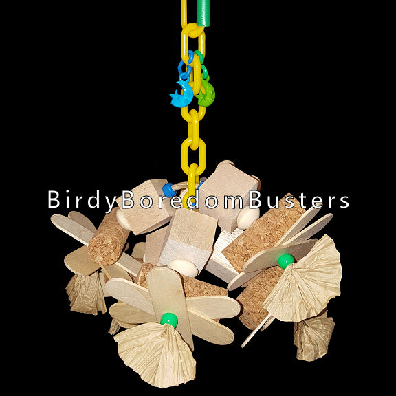 A combination of balsa blocks, cork stoppers, thin wood paddles and paper bows on a length of plastic chain. A shredders dream come true!  Designed for small to intermediate sized birds. Measures approx 7
