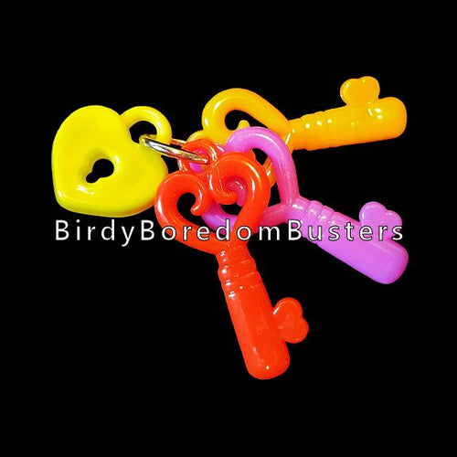 Designed for little beaks & feet! A light-weight foot toy made with small acrylic keys attached to a little heart charm.  Measures approx 2