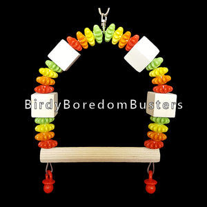 "A cute little swing made with spinning gear beads and wood cubes on stainless steel wire. Designed for small birds such as budgies, lovebirds, parrotlets, canaries, etc.  Measures approx 4"" wide by 6"" tall including link."