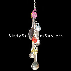 Four stainless steel measuring spoons with colorful acrylic charms linked on a nickel plated chain with pear links on each end. This toy can be hung either horizontally or vertically in your bird's cage.