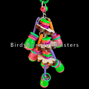 "Your bird is sure to have a fiesta with this colorful toy! Mini maracas, pine daisies, lots of rubber rings and neon flower rings strung on nickel plated chain for your bird to shake & rattle! For small beaks only (budgies, linnies, parrotlets, etc).  Hangs approx 3"" by 8""including link."