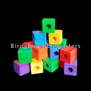 "Small, brightly colored soft wood cubes measuring approx 5/8"" with a 3/16"" hole. Recommended for making small and intermediate bird toys.  Package contains 50 pieces."