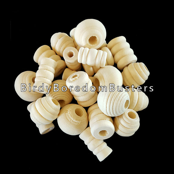 An assortment of uncolored wood beads in different shapes. Sizes depend on the shape, but average approx 3/4