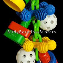 "Load image into Gallery viewer, Giant plastic nuts & bolts with perforated golf balls and big InterStar rings all hanging on a plastic chain with a large nickel plated cow bell on the bottom to make some noise with. A great toy for mechanically inclined birds like cockatoos!  Hangs approx 14"" including quick link."