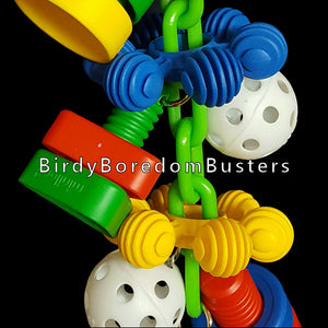 "Giant plastic nuts & bolts with perforated golf balls and big InterStar rings all hanging on a plastic chain with a large nickel plated cow bell on the bottom to make some noise with. A great toy for mechanically inclined birds like cockatoos!  Hangs approx 14"" including quick link."