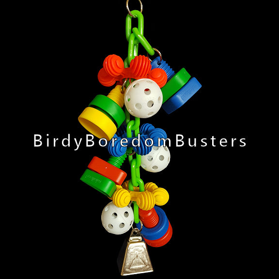 Giant plastic nuts & bolts with perforated golf balls and big InterStar rings all hanging on a plastic chain with a large nickel plated cow bell on the bottom to make some noise with. A great toy for mechanically inclined birds like cockatoos! Hangs approx 14