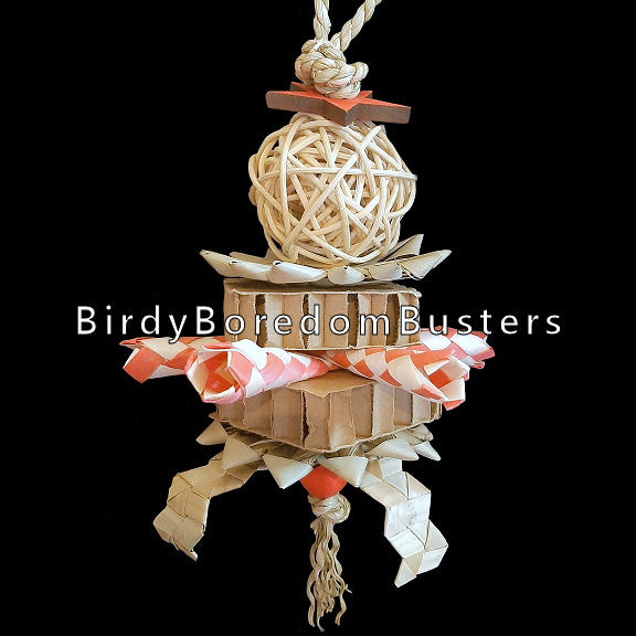 Made with a twisted vine ball, palm leaf flowers, cardboard blocks, bamboo shredders, zigzag shredders and pine stars strung on seagrass cord. Contains no metal parts.  Hangs approx 10