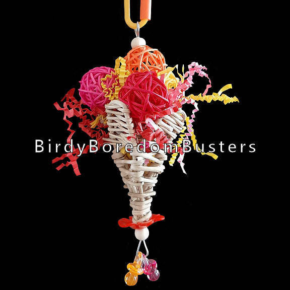 A colorful treat for small birds who like to pick and shred! Four colored vine balls and crinkle cut paper stuffed into a vine cone. Built on stainless steel wire. Available in assorted colors. Tip: Stuff some little treats inside the cone for extra foraging fun!  Hangs approx 7