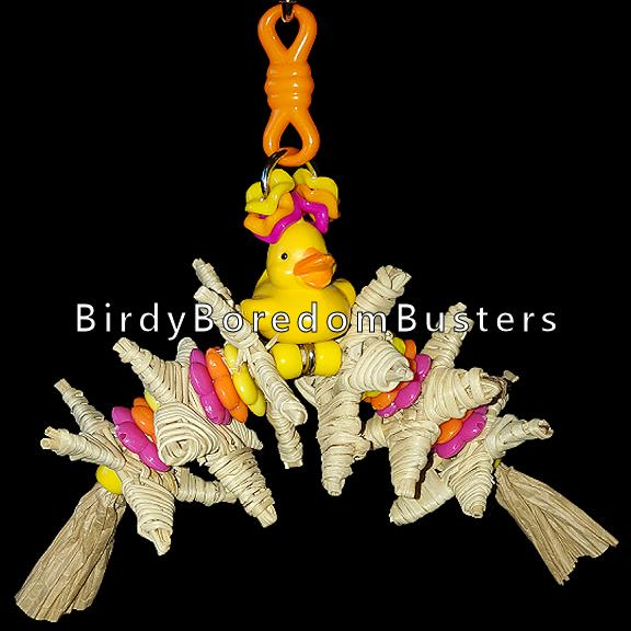 A beak tempting array of small crunchy vine stars with bright beads & daisy rings on paper rope dangling under a little duck.
