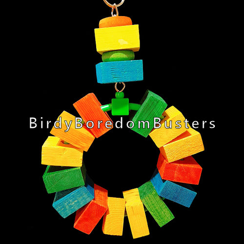 Brightly colored chunky pine blocks on a sturdy plastic ring hanging from nickel plated chain with more blocks and hardwood disk rings.  Measures approx 6-1/2