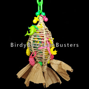 "Stuffed full of crinkle cut paper with little charms, this vine ""torpedo"" is a perfect foraging toy for small birds! Hide special treats inside to keep your bird busy. The paper bows will provide additional shredding fun. This toy has no metal parts.  Measures approx 2-1/2"" by 8"" including link."