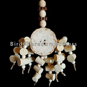 "Two dozen corks with little wood beads dangling from a 1-3/4"" thick yucca round with pine daisies and wood beehive beads. Designed for small to intermediate sized birds.  Hangs approx 6"" by 11"" including link."