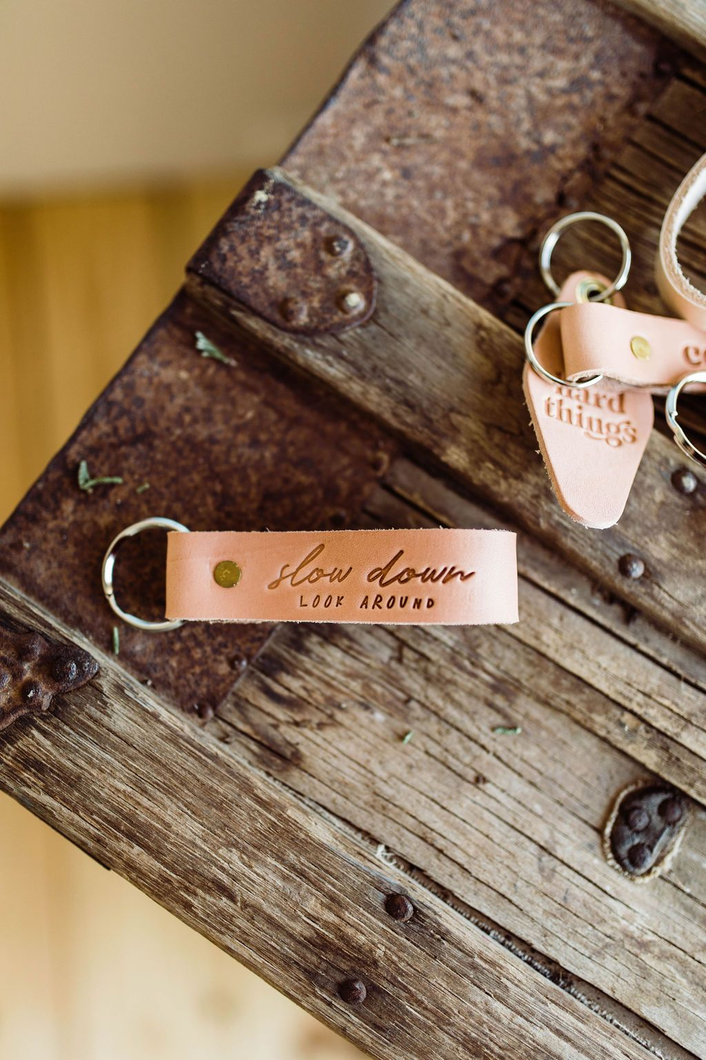 Slow Down Look Around Leather Keychain
