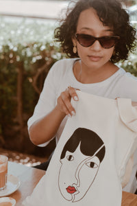 Theophilia Collection Freedom tshirt and Sishwati Marie tote Bag lifestyle image.