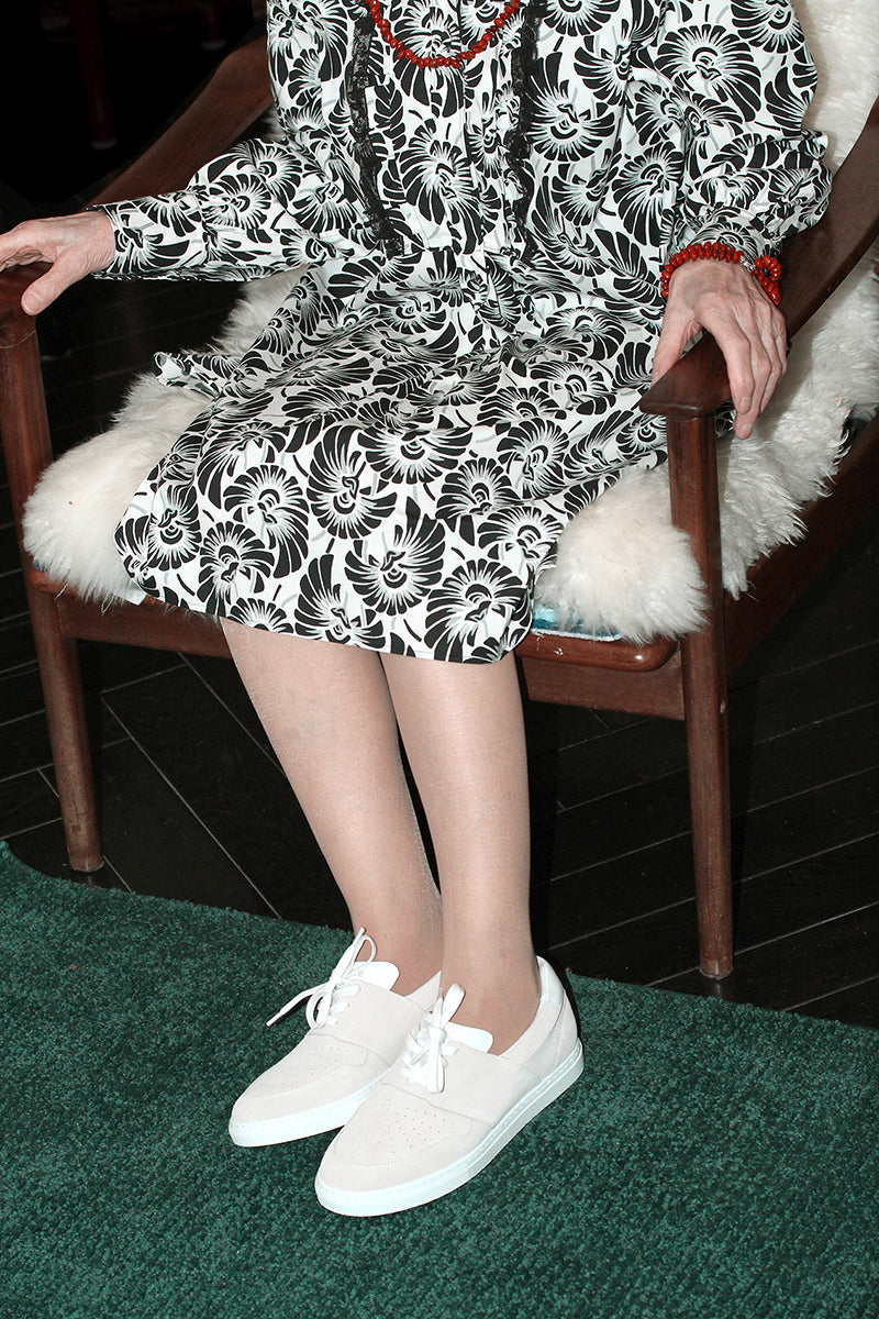 madame-a-wearing-pyla-wheat-shoes-sat-down-on-a-sofa-timothee-paris-big-size-picture