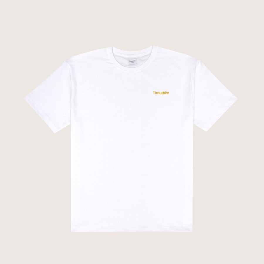 white-short-sleeve-embroidered-timothee-paris-logo-on-chest-oversized-tshirt-front-view-honey-gold
