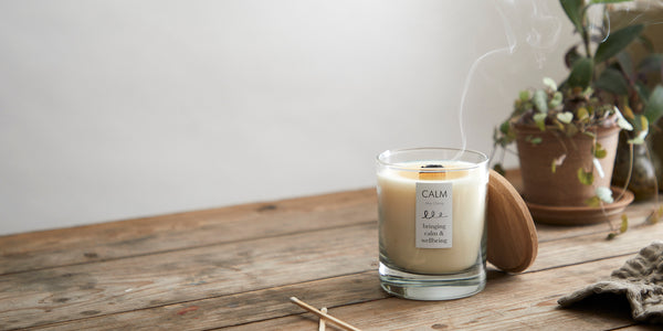 soy candle with wooden wick that had been blown out leaving a smoke ring