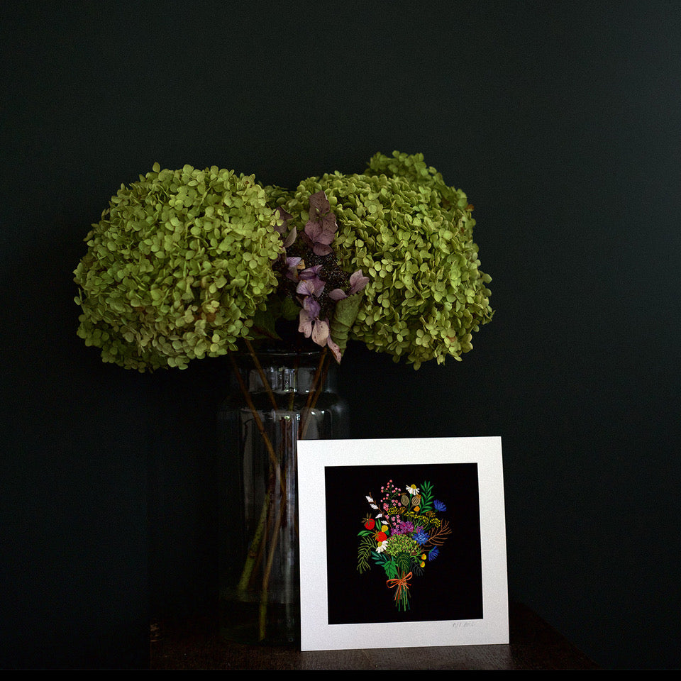 Dark moody room with a Art print resting against a vase of flowers